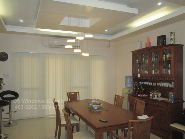 Fabric vertical blinds in dining area