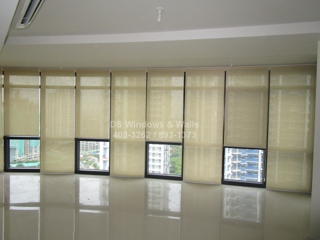 Roller blinds for long glasswall